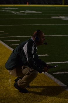 Head football coach Brian Glesing analyzes the play during the football game against Seymour.