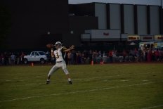 Sophomore Matt Weimer passes the ball to junior Antonio Villegas.