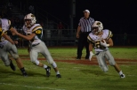 Junior Colt May runs the ball up the side of the field.