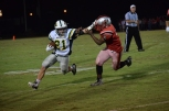 Junior Colt May stiff arms Jeffersonville junior Anthony Malone as he moves the ball up the field.