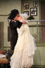 Junior Chase Bishop and senior Arielle Conrad share a passionate on stage kiss.