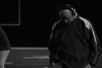 FC head coach Brian Glesing walks with his head down after FC fails to convert a crucial first down in the third quarter.