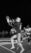Sophomore Matthew Weimer's pass to senior Paden Pikey is intercepted.
