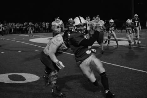 Sophomore Zach Spurgeon runs the ball out of bounds before being tackled.