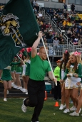 Senior Hunter Hampton waves the FC flag and leads the football team out of the student tunnel at the football game against Jennings County on Oct. 9.