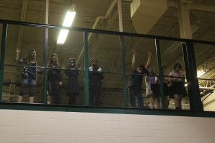 The cast of the Haunted house looks down upon the crowded gym. Photo by Delaney Smith.