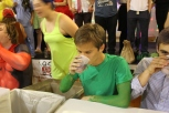 Junior Carson Conley drinks a mystery beverage during the eating contest. Photo by Delaney Smith.