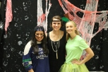 Junior Inaara Ladha as a sports fan (far left), senior Paige Vellinger as a flapper girl, and senior Mikayla Koch as part of a fruit salad (far right).
