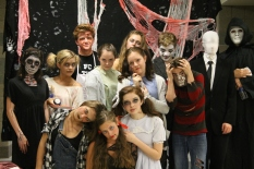 "From left to right at the top: junior Gage Griffin as Psycho, sophomore Josey Waterboy as Psycho, freshman Noah Hankins as Psycho, sophomore Jordan Burger as Slenderman, and English teacher Tim Romig. From left to right in the middle: junior Morgan Prentiss as a skeleton, freshman Stevie Griffin as a ""creepy girl,"" sophomore Allie Lincoln as an old lady, sophomore Anna Thomson as a doll, and sophomore Evan Stanfield as Psycho. From left to right at the bottom: junior Aubrey Spencer as Psycho, junior Brooklyn Ivey as a doll, and freshman Elizabeth Hallal as a ""demon girl."""