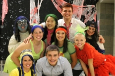 From left to right at the top: senior Erin Bertram as Sadness, senior Annie Sung as Disgust, junior Lucas Willman as Anger, and junior Inaara Ladha as a sports fan. From left to right in the middle: senior Kristen Burger as Joy, junior Sydney Laduke as the Sundrop girl, and senior Kylie Wheeler as part of a fruit salad. From left to right at the bottom: technology specialist and psychology teacher Katrina Uhl and junior Nikolas Vellinger.
