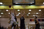 Junior Trevor Apple drives and shoots the ball at the basket.