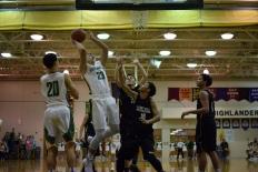 Sophomore Luke Gohmann shoots a layup under the basket.