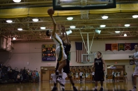 Freshman Cobie Barnes puts the ball past the defender for a basket.