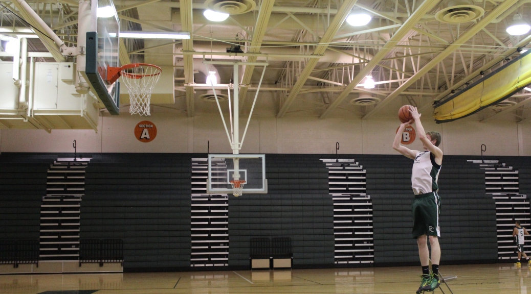 Boys basketball team prepares for green and gold for How much to build a basketball gym