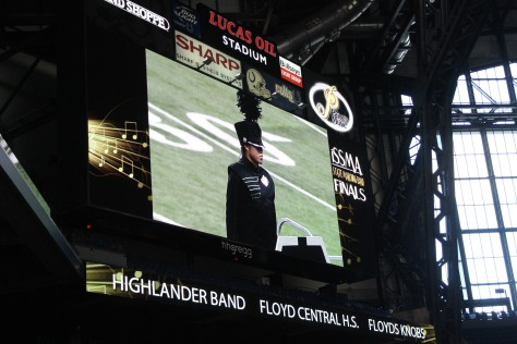 Senior Yuriko Tashiro is displayed on the big screens as she leads the band in their performance. Photo by Christine Scharrer.
