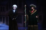 Junior Chase Bishop, as Christmas Present, takes sophomore Will DeVary to see the Cratchit family.