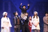 """Tiny Tim, played by Xander Essex is hoisted onto sophomore Will DeVary's shoulders as the play draws to a close. """"This show has a very special place in my heart for a number of reasons,"""" said DeVary."""
