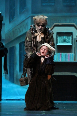 """Sophomore Sam Moore strangles his cast member, sophomore Will DeVary, during the late hours of the night. """"I tried to live up to so many wonderful Scrooge's that I recall watching with awe as a child,"""" said DeVary."""