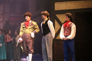 """Senior Will Huston chats about his wife to sophomores Logan McNeeley and Mitchell Lewis. """"Everyone in the cast delivered such interesting performances,"""" said DeVary."""