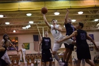 Sophomore Jake Canter drives to the basket as he scores a layup.