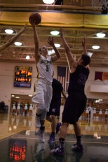 Junior Tyler Kimm shoots a layup while being defended.