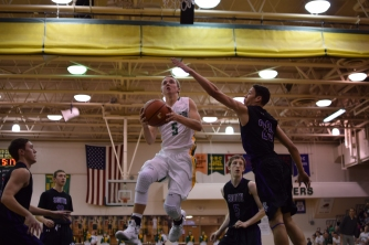 Junior Tyler Kimm shoots a layup.