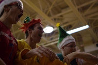 Seniors Brady Miles, Aidan Flannigan, and Kyle Peters celebrate after FC scores a basket.