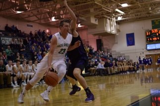 Sophomore Luke Gohmann drives towards the basket.