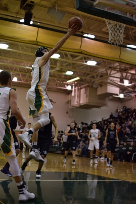 Senior Connor Sturgeon makes a wide open layup.