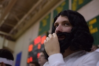 Senior Chris Rogers watches the warmups.