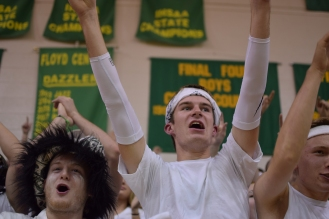 Seniors Kyle Peters and Aidan Flanigan cheer for FC as the team comes out.