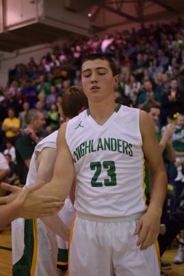 Sophomore Luke Gohmann shakes hands with freshman Cobie Barnes during starting lineups.