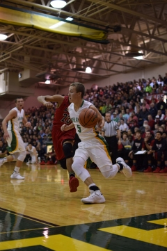 Junior Tyler Kimm drives the ball towards the basket.