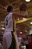 Junior Tyler Kimm passes the ball in bounds.