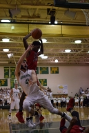 Senior Connor Sturgeon is fouled on the shot under the basket.