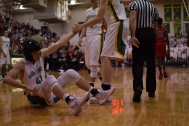 Senior Connor Sturgeon is helped up after being fouled.