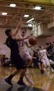 Sophomore Jake Canter is contested as he shoots a layup.