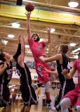 Senior Connor Sturgeon takes a shot while being guarded by several Corydon players.