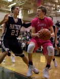 Sophomore Matthew Weimer works the ball under the basket.