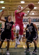 Junior Tyler Kimm shoots a layup. The Highlanders wore pink jerseys in support of breast cancer awareness.