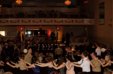 Cadets and their dates form a congo line.