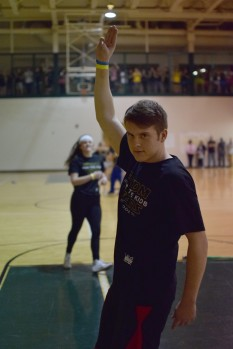 Junior Chase Stepp salutes the crowd before the start of the event.