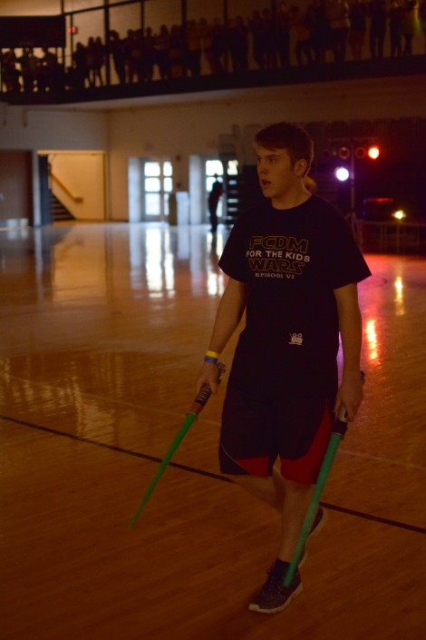 Junior Chase Stepp wields two lightsabers during the Hunger Games.