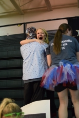 Seniors Justin Applebaum and Kylie Wheeler hug and share their joy as the total is revealed.