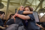 "Senior Kylie Wheeler embraces senior Lucy Reising with tears of joy. ""I am speechless. Three weeks ago we had a meeting saying there was no way metting a hundered thousand was even in range for us. Everybody came together because we knew that we were going to do this for the kids,"" said Wheeler."