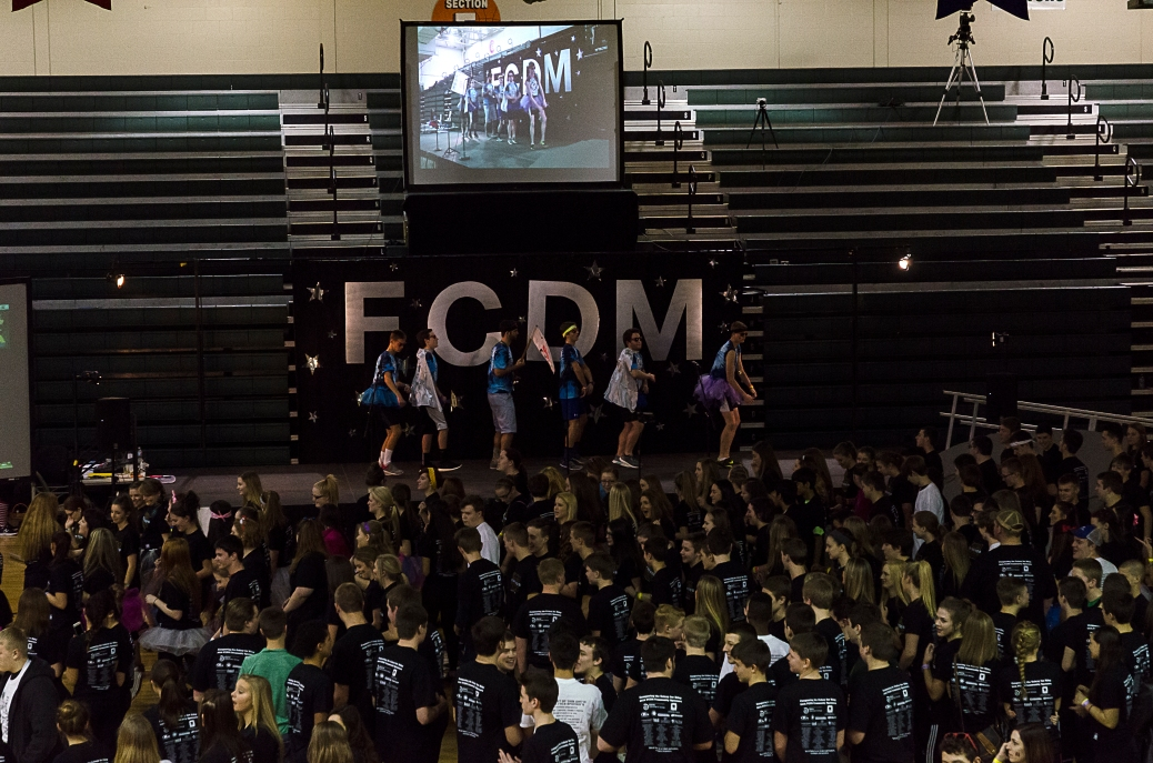 FCDM starts the first dance as dancers continue to pour into the gym. Photo by Robert Wormley.