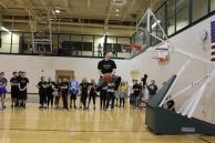 Senior Phillip Archer jumps before he dunks the ball.