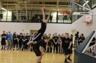 Junior Dave Dorsch leaps over junior Chase Stepp as he tries to dunk.
