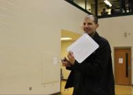 Science teacher C.J. Jackson helps score the dunk contest.