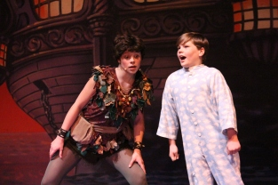 After defeating Captain Hook, junior Brooklyn Ivey teaches fourth-grader Griffin Scribner how to crow.